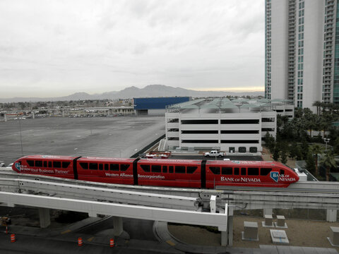 Bank of Nevada Monorail Train rides down track on a cloudy day