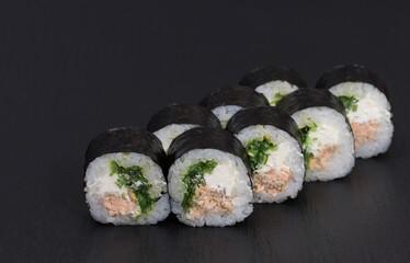 Fototapeta Sushi Rolls Sake Chukka with RICE, FRIED SALMON, CREAM CHEESE, WAKAME and SEZAM obraz
