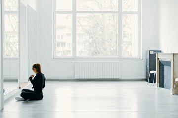 female dancer at the dance school gets ready for the performance in front of the mirror