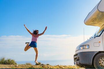 Woman enjoy trip with motorhome