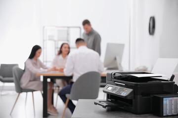 Fototapeta New modern printer on table in office. Space for text