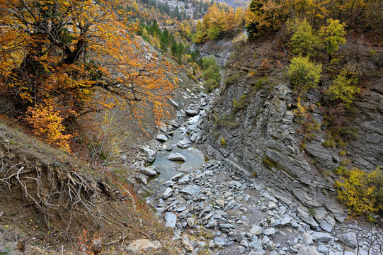 Mountain landscape with part of Haliacmon river on Mount Gramos in northern Greece during autumn