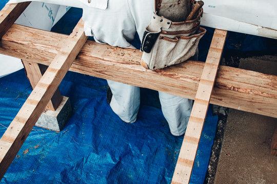 Senior Carpenter Repairing Floor