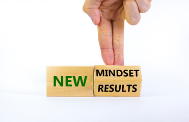 New mindset and results symbol. Businessman turns the wooden block and changes words 'new mindset' to 'new results'. Beautiful white background. Business, new mindset and results concept. Copy space.