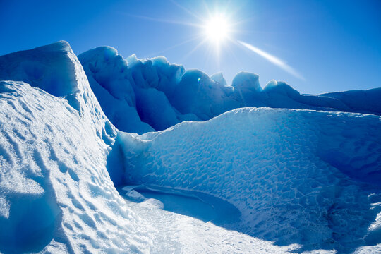 Scenic View Of Glaciers Against Blue Sky