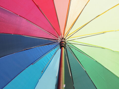 Low Angle View Of Umbrella Bright Colorful Rainbow Umbrella Background Lgbt Concept