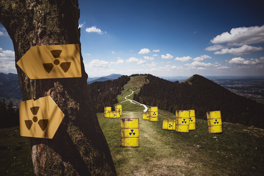 Composite Image Of Yellow Barrels With Radioactive Warning Symbol