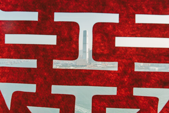 City Seen Through Red Wall