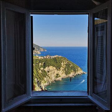 Scenic View Of Sea Seen Through Glass Window