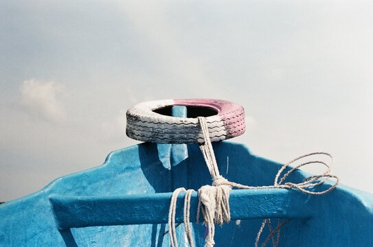 Close-up Of Rope Tied To Bollard Against Sky