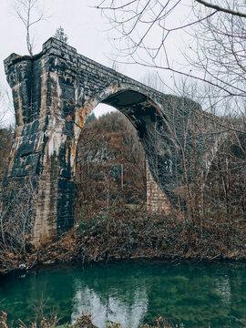 Old Bridge Over Green River. Stone Bridge, Ruins, Collapsed, Aqueduct, Winter, Outdoors.