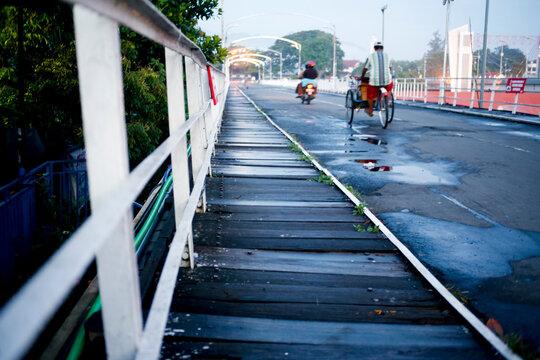 People On Footbridge In City