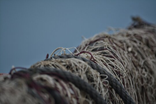 Close-up Of Fishing Net Against Clear Blue Sky
