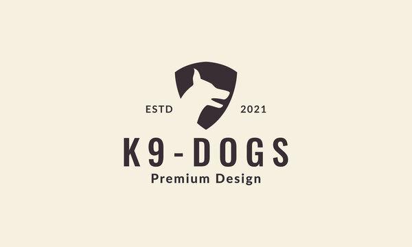 dog head with shield or guard silhouette logo vector symbol icon design illustration