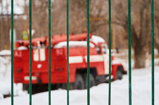 Truck Seen Through Metallic Gate During Winter