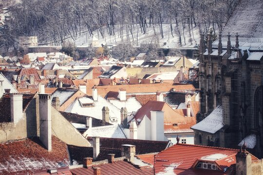 Buildings With Roofs Covered By Snow In Old Town