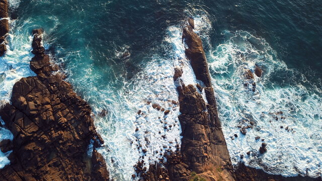 Waves Breaking Against The Rocks In Sri Lanka