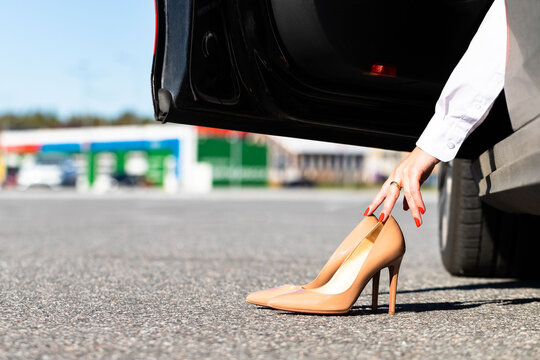 Woman Changes Clothes In Comfortable Shoes Before Driving, Sitting In Car, Close Up