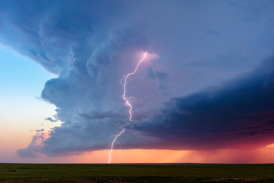 A Vivid Lightning Bolt Strikes From A Towering Supercell Storm At Sunset Near Briggsdale, Colorado.