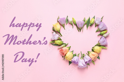 Happy Mother's Day. Flat lay composition with beautiful eustoma flowers on pink background