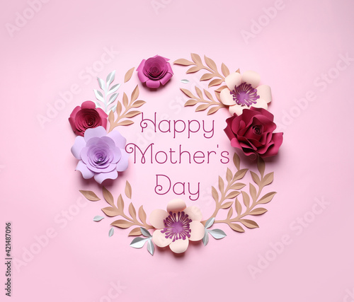 Happy Mother's Day. Frame of beautiful paper flowers on pink background, flat lay