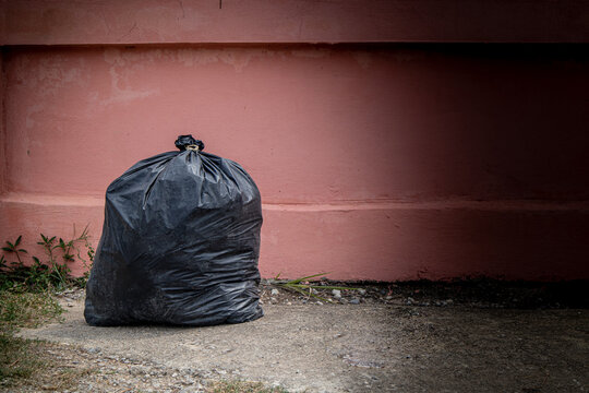 Close-up Of Garbage Bag By Wall Outdoors