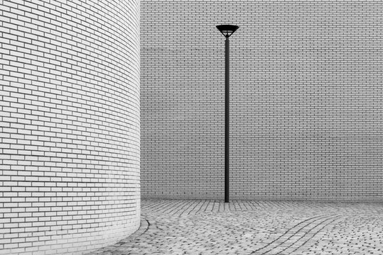 Close-up Of Street Light Against Wall