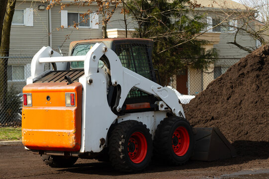 loader loads mulch, economy natural tree mill