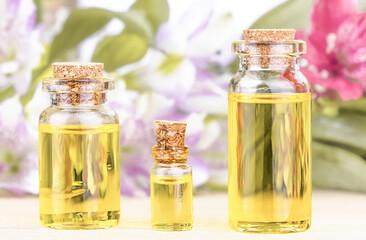 Bottles of floral essential oil. Alternative medical concept.
