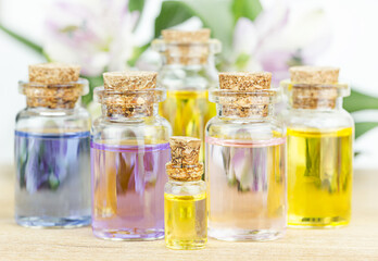 Set of colorful bottles with floral essential oil. Alternative medical concept.