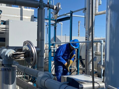 Industrial workers checking the temperatures at a LNG plant