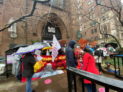 Activists gather outside Manhattan's Church of the Ascension to promote the rights of household cleaners in New York
