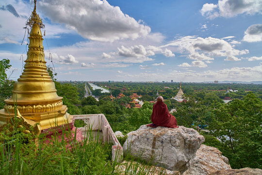 Praying on the rock, view from Mandalay Hill, Myanmar (Burma)