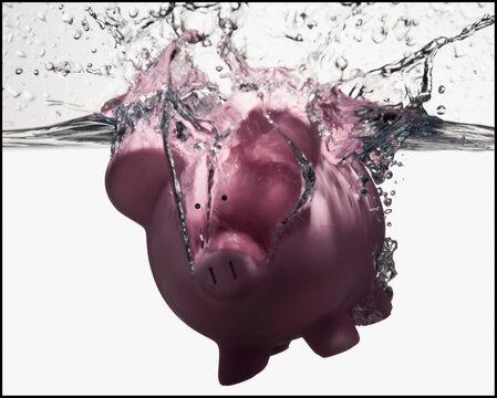 Piggy bank sinking in water