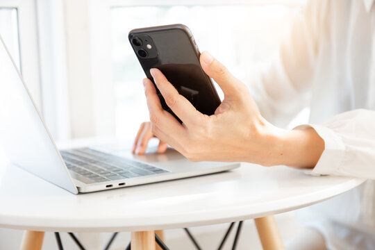 work using texting cell phone typing computer.student study education online learning.adult professional chatting on laptop,mobile contact us at Thinking business plan.connecting people concept