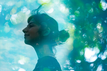 Obraz エコロジーイメージ・女性の横顔とアウトフォーカスで撮影した森の合成CG - fototapety do salonu