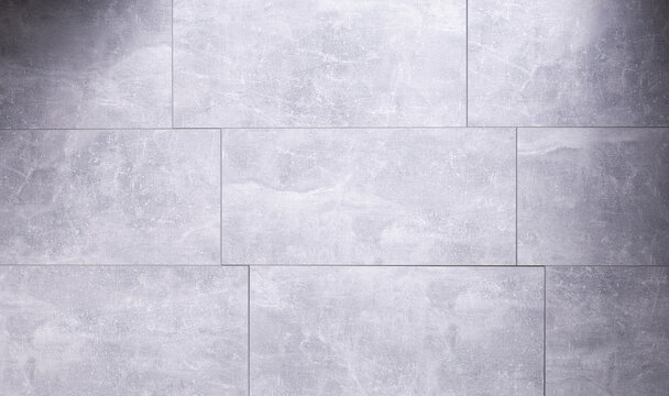 Stone or marble surface background of tile floor or wall texture.  Grey laminate background
