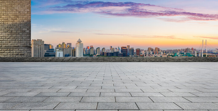 Empty square floor and Shanghai skyline with buildings at dusk,China.High angle view.