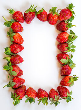 Strawberry frame on a white background. Berry background. Free space.
