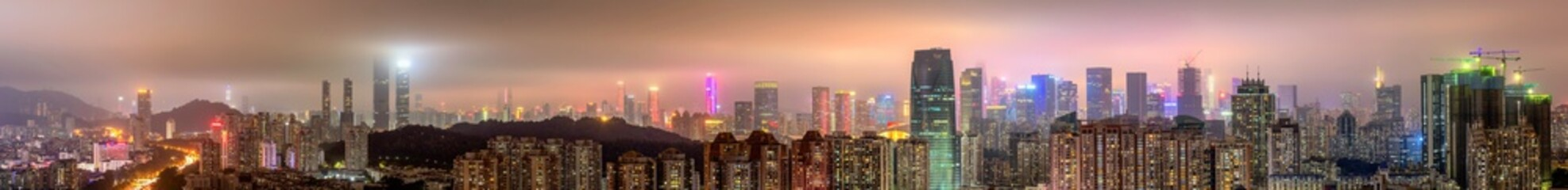 Panoramic View Of Illuminated Buildings Against Sky In City