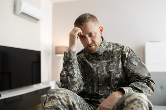 Disabled Military Soldier In Wheelchair With PTSD After Injury