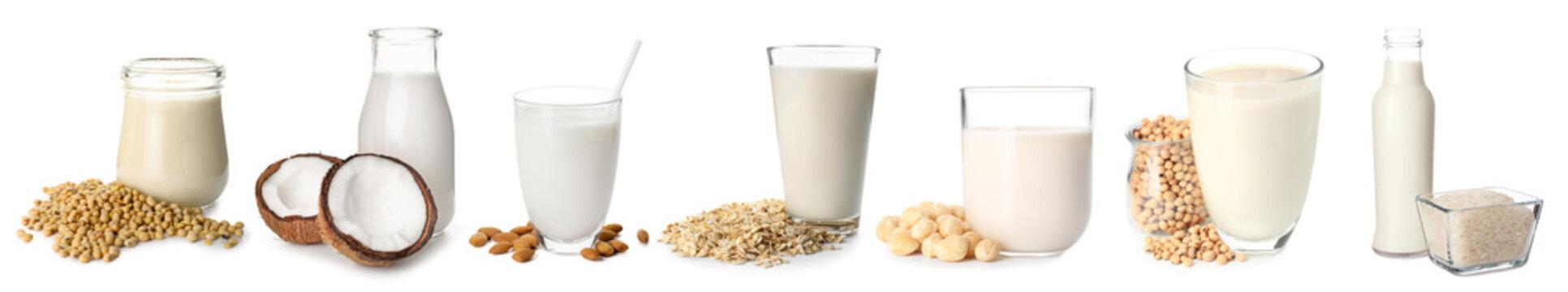 Different vegan milks on white background