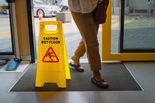 Yellow warning sign wet floor in shop.