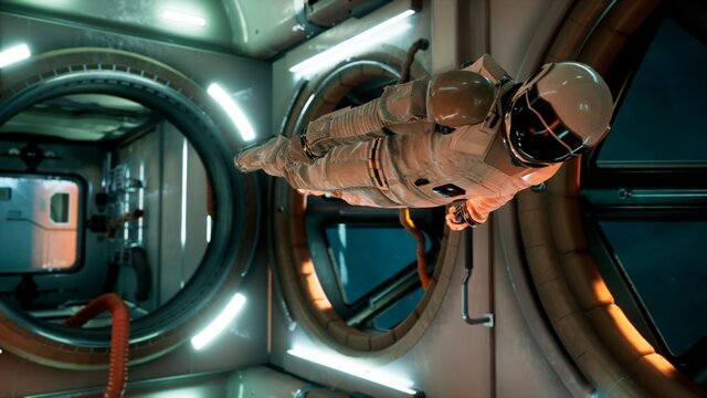 An astronaut in zero gravity checks the module of his spaceship. 3D Rendering.