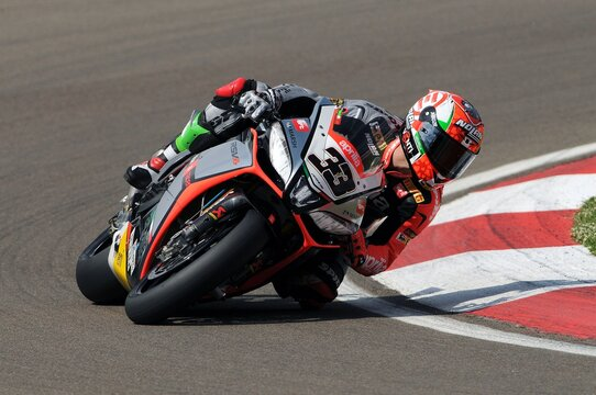 San Marino, Italy - May 10, 2014: Aprilia RSV4 Factory of Aprilia Racing Team, driven by Marco Melandri in action during the Superbike Practice on May 10, 2014 in Imola Circuit, Italy.