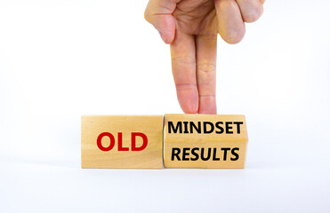 Old mindset and results symbol. Businessman turns the wooden block and changes words 'old mindset' to 'old results'. Beautiful white background. Business, old mindset and results concept. Copy space.