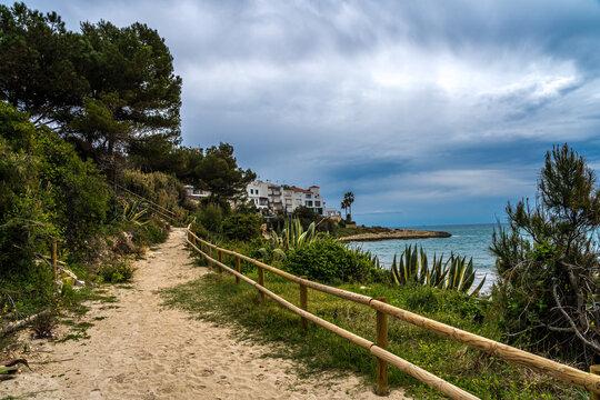sandy road by the mediterranean sea