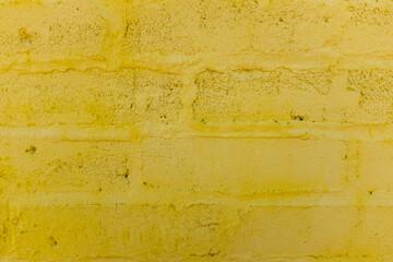 A painted yellow brick wall
