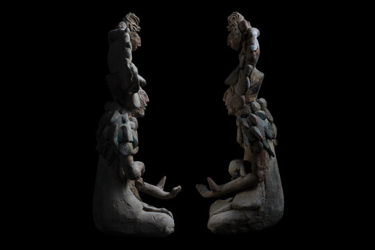 Clay-made Mayan sculptures of ancient shamans of Jaina island isolated on a black background