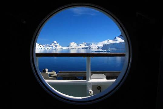 View of the Antarctic Peninsular from an expedition cruise vessels cabin porthole